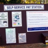 Pay Station Sign in the Parking Lot for Diana's Baths
