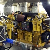 New Twin Caterpillar Bio Diesel Engines - Inside the engine room of the M/S Mount Washington Cruise Ship. Photo taken while ship was underway. The engine room is very loud, ear protection was a must to get this photo of the new caterpillar bio diesel engines.