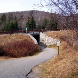 "The Entrance to ""The Basin"" From The I-93 North Bound Side Parking Lot - This is also the entrance to Kinsman Falls. Take this trail under I-93 to the beginning of the trail, trail is well-marked. You can also access Kinsman Falls using the southbound side of I-93."